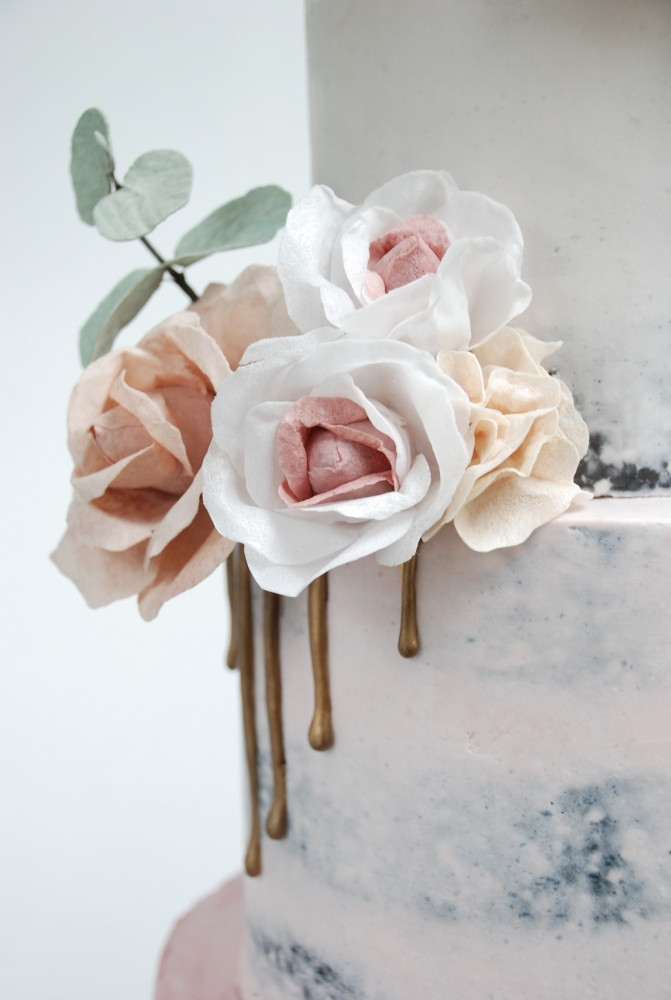 Wafer paper flowers on blush pink wedding cake