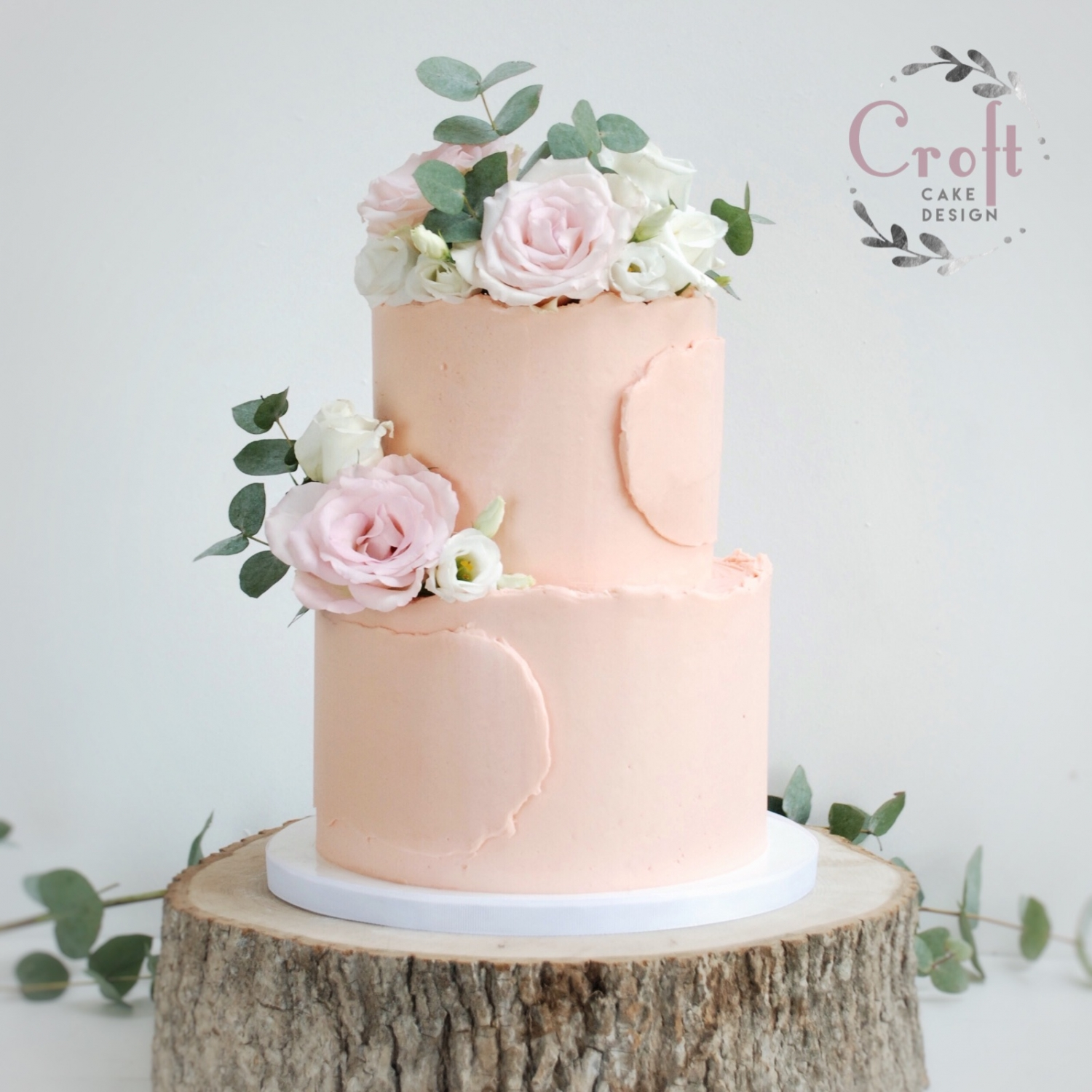 Buttercream wedding cake 2 tier with roses and eucalyptus