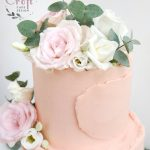 2 tier buttercream wedding cake with roses and eucalyptus