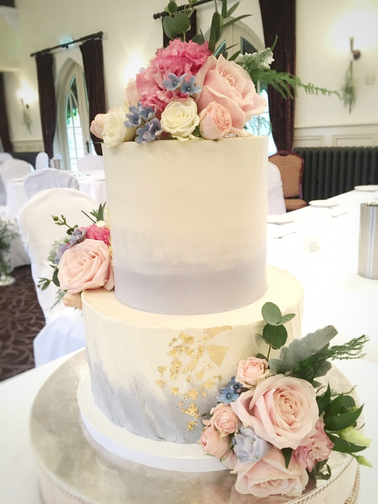 2 tier Buttercream wedding cake ombré effect with gold leaf