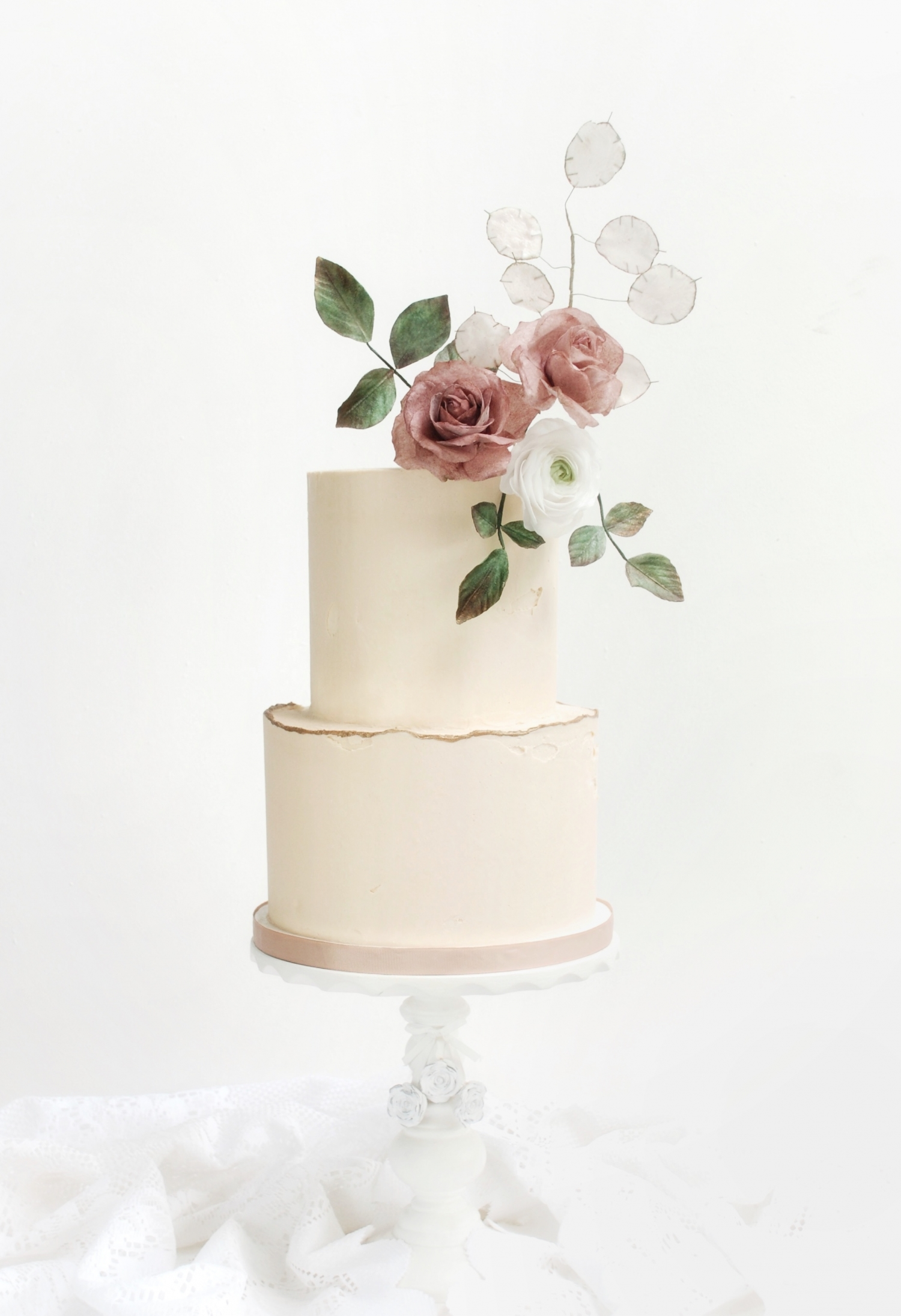 Elegant buttercream wedding cake with wafer paper flowers