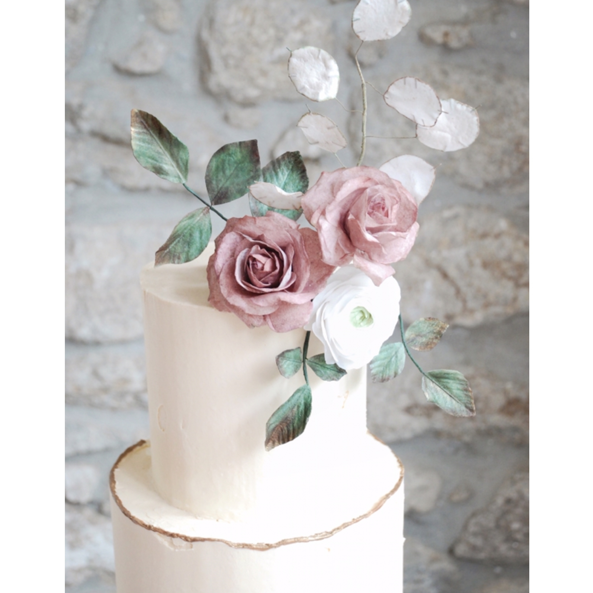 Elegant ivory wedding cake wafer paper flowers buttercream icing.