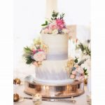 Two tier wedding cake buttercream grey and white pink roses.