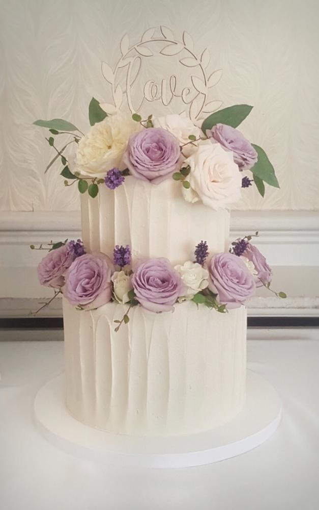 Textured buttercream wedding cake with fresh flowers