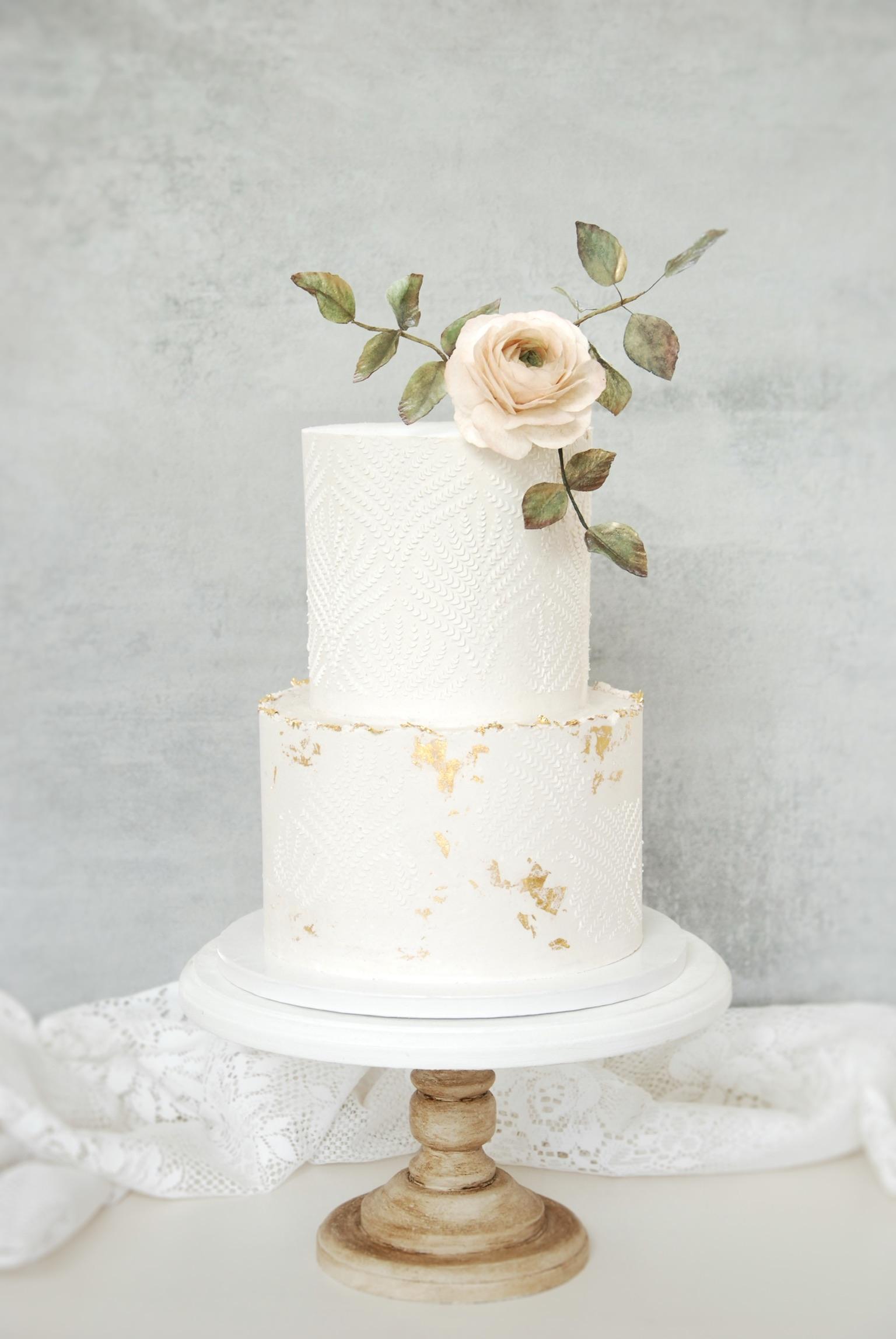 Ivory wedding cake gold leaf