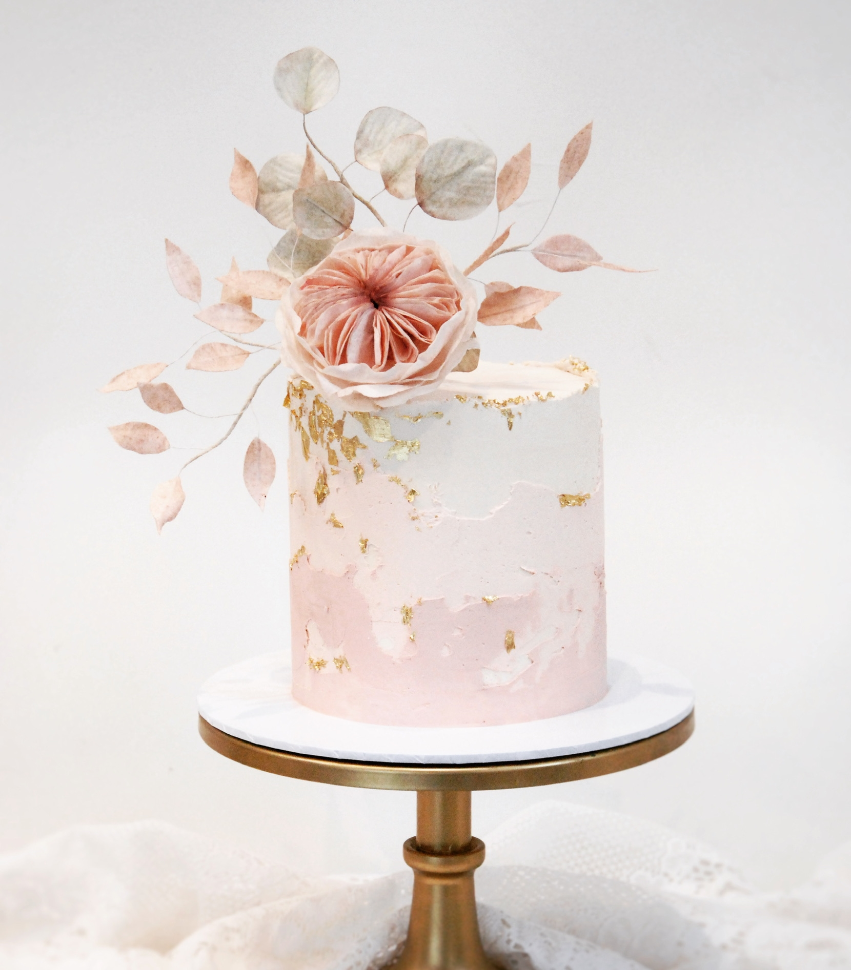 Single tier wedding cake with wafer paper flowers